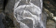 Selkie drawing done on a rock on Ynys Enlli