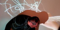 Antony moving, a young person drawing in the video projection