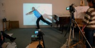 Simon moving, a young person drawing in the video projection