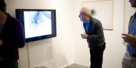 A man watching a video Installation and exhibition of work by Maria Hayes, Aberystwyth University School of Art, Wales UK