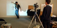 Students Jack and Tom drawing movement using the video projection
