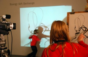 Dylan and Seren drawing movement with the video projection