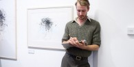 A man sketching at exhibition of work by Maria Hayes, Aberystwyth University School of Art, Oct 21 2011